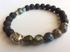 Item details 5 out of 5 stars. (23) reviews Shipping & Policies This bracelet has beautiful labradorite stones, black Onyx stones highlighted with antique silver pewter beads on a stretch cord.