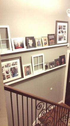 White picture ledges in a split level foyer