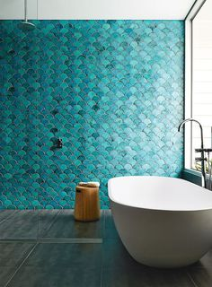 Keep up with tile trends. Fish scale tiles are a great way to update your kitchen or bathroom. Replace your subway tile with fish scale tile to stay on trend. For more design ideas and inspiration, go to Domino. Bathroom Inspiration, Interior Inspiration, Creative Inspiration, Design Inspiration, Interior Ideas, Blue Green Bathrooms, Bathroom Green, Bathroom Modern, Minimalist Bathroom