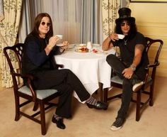 Ozzy Osbourne and Slash having a cup of tea.  love this photo