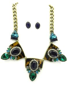 When you look in the mirror, what do you see? Are you sure?  Aged gold chain. Thick. Tortoiseshell plaques covered in rhinestones. Vintage style. Shourouk style. It's business time.  Necklace is 16 inches long. Earrings are standard post.