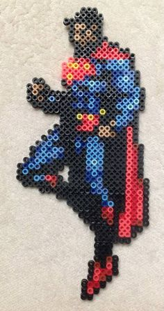 Superman Sprite Perler Bead Art by EightBitEvolution