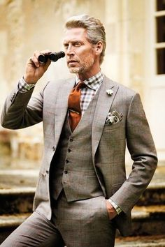 Men's Grey Plaid Blazer, Grey Pocket Square, Grey Plaid Waistcoat, Orange Tie, White and Brown Gingham Dress Shirt, and Grey Plaid Dress Pants