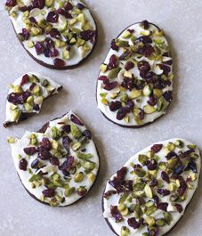 I can already taste these chocolate Easter egg cookies. Decorated with dried fruit and nuts, they're a healthy alternative to a sweet treat!