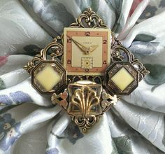 Vintage Style Diamond Shaped Collage Brooch  by FromABygoneTime, $30.00 This has a bit of an Art Deco look to it, especially the watch face.