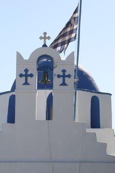 Greek Flag flying on the Church Cross Tower - Greek Island