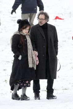 Helena Bonham Carter and Tim Burton out for a day of sledding with the kids.  Only Helena would go sledding in a floral dress and knee socks.