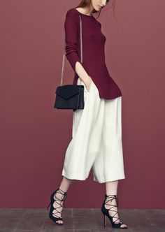 Autumn inspiration: a burgundy tunic styled with culottes and black lace-up sandals makes for the perfect on-trend fall ensemble.