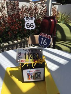 16TH Birthday Party with Road Trip theme.  Found the Interstate 16 and Route 66 signs on internet, printed and mounted on metal skewers.  We served food inspired by the US states on Route 66 which included Chicago Dogs, chips and salsa and macaroni n'cheese.   We also played minute to win it games.