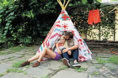 Fanny Bostrom and Bill Gentle in the backyard of their Williamsburg, Brooklyn home. Fanny, a multimedia artist from Sweden, made the teepee.