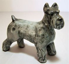 Vintage hand painted Schnauzer dog figurine Mottled gray, satin finish Hand painted 3 5/8 high x 4 inches long Unsigned, made of some sort of ceramic or pottery Good condition, gently owned, no chips or cracks Ships wrapped in bubble wrap and cardboard International buyers welcome Priority shipping options are offered 42917
