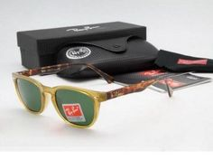 Ray Ban RB4140 768/51 sunglasses in Transparent yellow with Green crystal lens    Ray Ban RB4140 sunglasses will be famous star style in this summer.High quality acetate plastic frame matching pop color elements,blend of the classical Ray Ban Wayfarer style.Makes this style of Ray Ban sunglasses look so stunning and seize our eyes.2012 new collection styles, every known brand have the features of their own.Particularly Louis Vuitton sunglasses,Chanel sunglasses.etc.    Ray Ban RB4140…