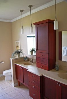 Cherry Vanity With Tower Cabinet. Floating Vanities With Tapered Legs.