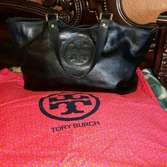 Authentic  Tory  Burch Has wear and tear. Not a brand new bag. More pics listed  in  closet Tory Burch Bags