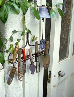 rake used as a garden tool holder