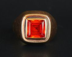 Ring for Men in solid 14K Rose Gold with bezel set polished cabochon of Red Ruby stone 12 mm x 10 mm x 5.3mm. The stone is lab made. Engraved decor on the shoulders .No hallmarks,likely this ring was made in 1940-1960s. Great used condition.The stone is firm and secure in its bezel.Wear to engravings. Size: 8.25 US /18.35 mm .This ring may be resized for additional payment. Weight: 4.4 gr