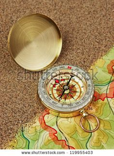 compass on the map with sand - stock photo