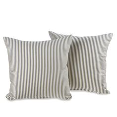 This set of decorative throw pillows features a ticking stripe design in blue and white. The simple pattern of these pillows ensures that they will nicely complement a variety of different decors.