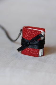 Items similar to Custom Made Book Necklace- Red leather, Black ribbon on Etsy Book Necklace, Black Ribbon, Red Leather, Custom Made, Cuff Bracelets, Amy, Necklaces, Trending Outfits, Unique Jewelry