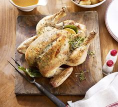 Lemon & thyme butter-basted roast chicken & gravy   Smoothing butter under the bird's skin helps to baste the chicken and herbs add a delicious flavour to the gravy
