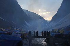 24 hours in pictures: Srinagar, India: Hindu pilgrims cross a bridge en route to Amarnath cave