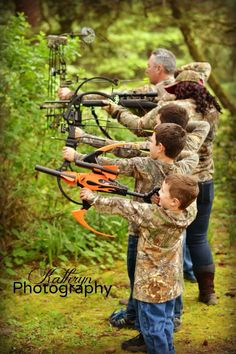 Family's that hunt together stay together!! Awesome family photo with bows and gun!!