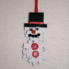 Follow the directions I provide here and you can create a Christmas tree ornament that looks like a snowman using old puzzle pieces.