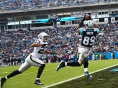 CHARLOTTE, NC - DECEMBER 23: Steve Smith #89 of the Carolina Panthers makes a touchdown catch against Joselio Hanson #23 of the Oakland Raiders during play at Bank of America Stadium on December 23, 2012 in Charlotte, North Carolina. (Photo by Grant Halverson/Getty Images)