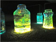 break open glowsticks and empty into water filled mason jars.