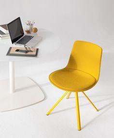 We present you a new version of the Lottus chair. Lottus Spin upholstered and estructure in a special yellow lacquer.  Os presentamos una nueva versión de la silla Lottus. Lottus Spin con tapicería integral y estructura lacada en color especial amarillo