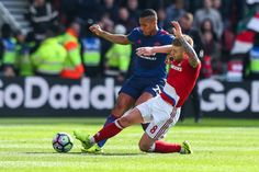 Antonio Valencia of Manchester United and Adam Clayton of Middlesbrough during the Premier League match between Middlesbrough and Manchester United...