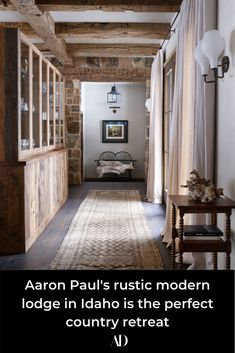 When Breaking Bad's Aaron Paul and his family need to get away from the city life of Los Angeles, they retreat to this riverside country home in Idaho. Take a tour of the actor's rustic yet modern lodge. #rural #wood #shiplap #cabin #logs #hollywood #JessePinkman #tv #television #Albuquerque #NewMexico #forest #woods #snow #winter #seasonal #warm #cozy #pendants #lighting #antlers #buffet #chinacabinet #curtains #textiles #rug #runner #sconce #beams #ceiling #bench #hallway #entry #foyer Modern Lodge, Modern Rustic, Cabin Style Homes, Rustic Home Design, Contemporary Home Decor, Industrial House, Vintage Home Decor, Decoration, Home Remodeling