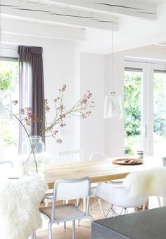 Dining room in an old farmhouse with a neutral base and lots of white and wood | Styling & Text Barbara Natzijl | Photography Margriet Hoekstra | vtwonen June 2015