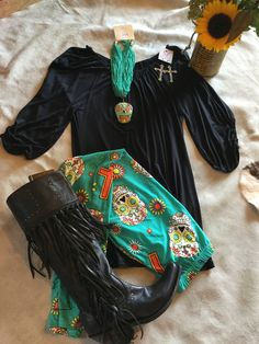 Black tunic with elastic sleeve, sugar skull leggings, liberty black boots , necklace and Pink panache cross earrings all available