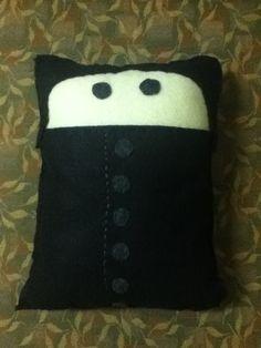Severus Snape. Pillows can be bought at etsy.com/shop/pokeypillows.