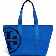 🆕Tory Burch Quilted Penn Tote Small 'Blue Macaw' a rich deep royal blue shade in quilted nylon. Durable and sporty in tapered trapezoid shape Black neoprene T-logo with blue embroidered border. Double top handle with black neoprene shoulder guard. One exterior slip pocket. Single compartment with top zip closure. One interior zip pocket, and two interior slip pockets.🚫Custom Bundle only🚫 Tory Burch Bags