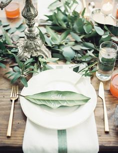Play up your natural themed wedding with some playful leaf place cards with all of your guests written on them! Want to see more? Check out Southern Weddings to see the rest of this wedding photographed by Geneoh Photography.