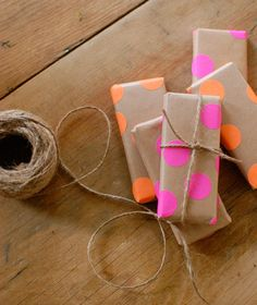 Fun Gift Wrap By Using Neon Stickers From The Office Supply