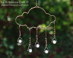 Rain Cloud Hanging Decoration - A copper wire cloud shaped ornament with five…