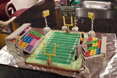 This was Mosaic Field in Regina, Saskatchewan, home of the Saskatchewan Roughriders. First one I ever made. Goal posts are Popeye sticks dyed yellow, field is green sugar, football made out of a peanut M&M and some royal icing.