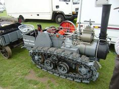A working scale model of England's magnificent Ruston Hornsby crawler tractor. The original was developed beginning 1904, and used in the Yukon from 1910.