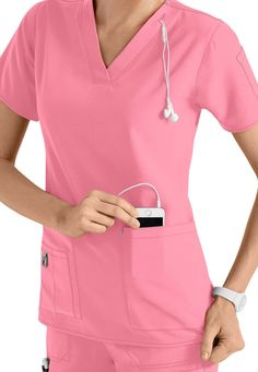 It's no wonder these Carhartt Crossflex scrubs have become one of our best sellers! The four-way stretch fabric (in Pink Rose)  is light and breathable and will feel great all shift long. But what separates this scrub top from the others is the innovative design that makes it easy to carry your portable media device, including an ear bud holder and cell phone pocket with media port!