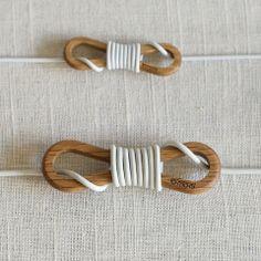 Wrapqarw, designer wooden cord organizer