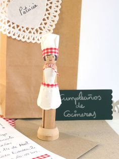 A little chef cake topper made from a vintage-style clothespin
