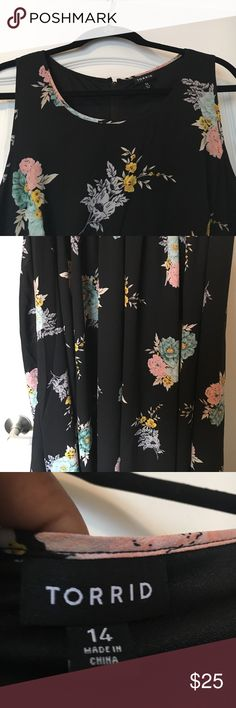 Beautiful floral sleeveless dress. Flowing beautiful floral sleeveless dress. Dress has never been worn and is free of rips and stains. Torrid Dresses