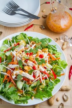 Sweet Chili Chicken Salad (chicken breast, lettuce, bean sprout, red bell pepper, carrot, cucumber, scallion, coriander, mint, basilpeanut, coconut milk, peanut butter)