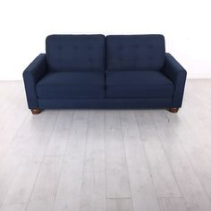 Evening Blue Sofa. - Dark blue sofa with wooden legs- Comfortably seats two- Great condition
