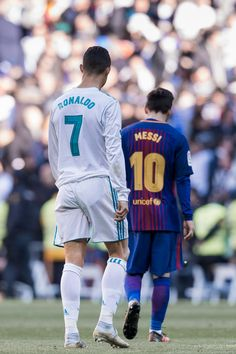 Lionel Messi of FC Barcelona and Cristiano Ronaldo of Real Madrid walk off pitch during La Liga match between Real Madrid and FC Barcelona at Santiago Bernabeu stadium on December 2017 in Madrid,. Get premium, high resolution news photos at Getty Images Cristiano Ronaldo Portugal, Cristiano Messi, Messi Vs Ronaldo, Ronaldo Real Madrid, Real Madrid Team, Neymar Barcelona, Messi And Ronaldo Wallpaper, Cristiano Ronaldo Wallpapers, Portugal National Football Team