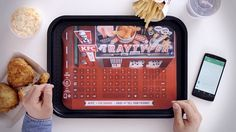 #Video showing the way the #KFC bluetooth keyboard tray cover works. A great marketing gimmick used among others for restaurant openings. In the case of an opeing in Germany the marketing agency reported a 100 percent take-away rate of these innovative marketing items.