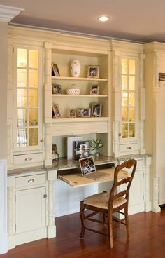 Kitchen office station? Glass helps break up the cabinetry. Nice decorative touches.